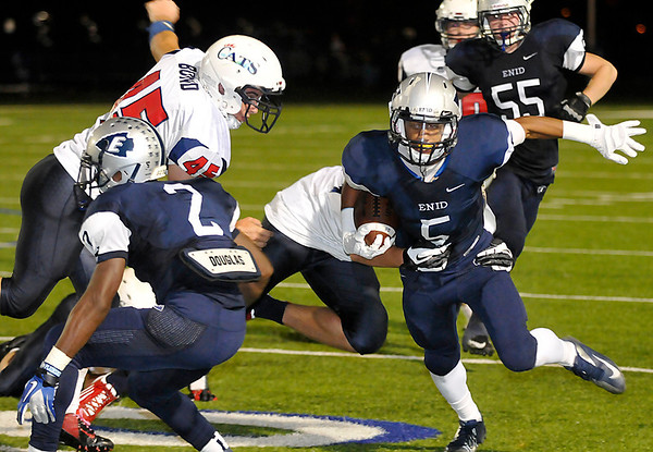 Enid's Johnny Lawrence struggles for yardage against Ponca City Friday at D. Bruce Selby Stadium. (Staff Photo by BILLY HEFTON)