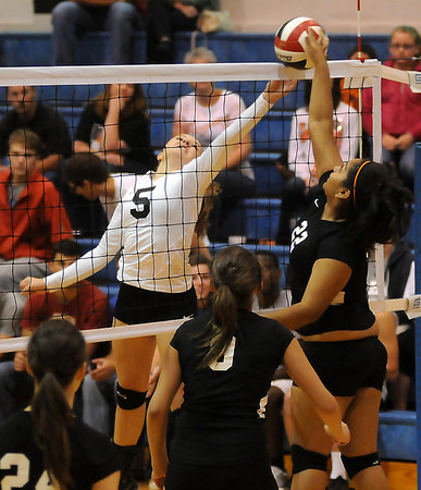 OBA's Sydney Downing uses a soft touch at the net with Guymon's Gloris Villa as Downing scores for the Lady Trojans Tuesday during the volleyball regional finals at Oklahoma Bible Academy. OBA took a commanding lead 25-11 and 25-17 in the match. (Staff Photo by BONNIE VCULEK)