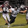 Garber's Alec Monsees returns a kickoff against Garber Friday at Garber High School. (Staff Photo by BILLY HEFTON)