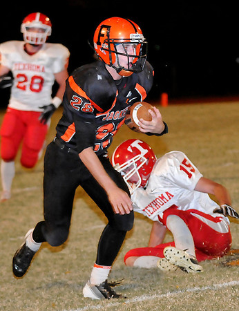 Fairview's Joel Kliewer gets away from Texhoma's Will Gaillard after catching a pass Thursday at Eubanks Field in Fairview. (Staff Photo by BILLY HEFTON)