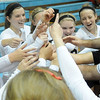 The Oklahoma Bible Academy Lady Trojans celebrate their 2-0 game lead over the Guymon Lady Tigers Tuesday during the regional volleyball tournament at OBA. (Staff Photo by BONNIE VCULEK)