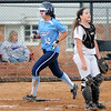 Enid Pacers' Courtney Chelf (left) scores behind Woodward's McKenzie Hunter Monday at Pacer Field. Chelf's stand up triple scored Haven Bay and Shannon Mueller prior to her run in the bottom of the first inning against the Boomers. (Staff Photo by BONNIE VCULEK)