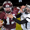 Garber quarterback, Jordan Avants, fends off Austin Matlock of Pond Creek-Hunter Friday at Garber High School. (Staff Photo by BILLY HEFTON)