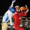 Chisholm's Danner Kiernan pulls in a touchdown pass behind Newkirk's Thomas Lusk Friday at Chisholm High School. (Staff Photo by BILLY HEFTON)