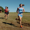 Cross country runners from Chisholm and OBA runs during the regional meet at Crosslin Park Saturday. (Staff Photo by BILLY HEFTON)