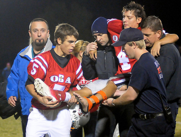 OBA's Adrian Moore is carried off the field after he was injured during a game against the Okeene Whippets at Commitment Field Friday. (Staff Photo by BONNIE VCULEK)