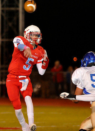 Chisholm's Tabor Charles throws a pass against Newkirk Friday at Chisholm High School. (Staff Photo by BILLY HEFTON)