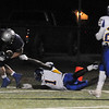 Enid's Seth Handley scores the Plainsmen's first touchdown Friday as Stillwater's Chuck Neal defends at D. Bruce Selby Stadium. (Staff Photo by BONNIE VCULEK)