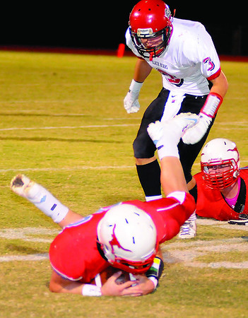 Chisholm's Bryce Stewart recovers a fumble by Pawnee's Browning Nicolet during the Longhorn's seventh win of the season Friday, Oct. 25, 2013. (Staff Photo by BONNIE VCULEK)