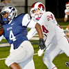 Enid's Raeshaan Finley out races Owasso's Josh Kinzer to the endzone during the second quarter Friday at D. Bruce Selby Stadium. (Staff Photo by BILLY HEFTON)