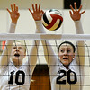 OBA's Brooklyn Wiens and Kendra Kroeker go up to block a shot against Guymon during the regional tournament Tuesday. (Staff Photo by BILLY HEFTON)