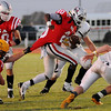 OBA Trojans' Chris Walker drags a Beaver lineman as he splits two Dusters for additional yardage at Commitment Field Saturday, Oct. 5, 2013. In the second quarter, Walker scored on a 31-yard run to give the Trojans a 6-0 lead over Beaver. (Staff Photo by BONNIE VCULEK)