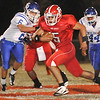 Ringwood's Eudaldo Gomez breaks through the Covington-Douglas defense for a long touchdown run Thursday at Ringwood High School. (Staff Photo by BILLY HEFTON)