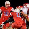 Chisholm's Karsten Brady (10) and Austin Swann (11) tackle Pawnee quarterback, Marlon Houston (5), during the Longhorns' win Friday, Oct. 25, 2013. (Staff Photo by BONNIE VCULEK)