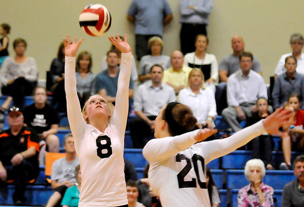 OBA's Ashley Atwood sets the ball for Kendra Kroeker against Guymon during the regional tournament Tuesday. (Staff Photo by BILLY HEFTON)