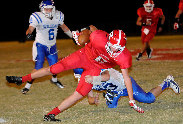 Ringwood's Cole Swart maintains his balance as he avoids a tackle attempt from Cody Taylor of Covington-Douglas to score a touchdown on a run after catch Thursday at Ringwood High School. (Staff Photo by BILLY HEFTON)