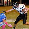 Pond Creek-Hunter's Josh Irvin eludes Waukomis's Zach Prince for an additional five yards during the Panthers' win over the Chiefs Thursday, Oct. 3, 2013. (Staff Photo by BONNIE VCULEK)
