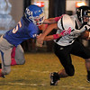 Waukomis's Zach Prince tackles a Pond Creek-Hunter running back Thursday, Oct. 3, 2013. (Staff Photo by BONNIE VCULEK)