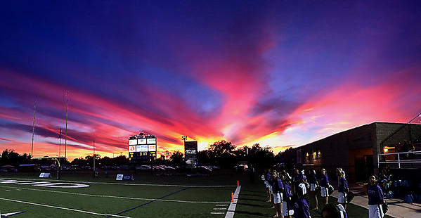 Fans attending the Enid vs Lawton game Friday at D. Bruce Selby Stadium were treated to a special sunset. (Staff Photo by BILLY HEFTON)