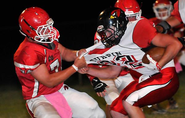 Kremlin-Hillsdale's Austin Dasilva pulls down Turpin quarterback, Matt Young, Friday October 2, 2015 at Kremlin-Hillsdale High School. (Billy Hefton | Enid News & Eagle)