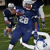 Enid's Devin Pratt breaks the tackle attempt of Stillwater's Gannon Reese Friday October 30, 2015 at D. Bruce Selby Stadium in Enid. (Billy Hefton / Enid News & Eagle)
