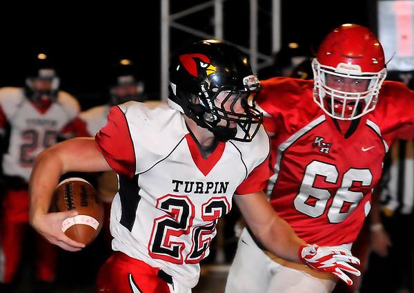 Turpin quarterback, Matt Young, tries to run away from Kremlin-Hillsdale's Briley Craig Friday October 2, 2015 at Kremlin-Hillsdale High School. (Billy Hefton   Enid News & Eagle)