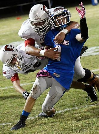 Waukomis' Lane Briggs is brought down by Cherokee's Caleb Roberts Friday October 14, 2016 at Waukomis High School. (Billy Hefton / Enid News & Eagle)