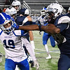 Enid's Marlo Hughes stiff arms Deer Creek's Jarett Burright Friday October 7, 2016 at D. Bruce Selby Stadium in Enid. (Billy Hefton / Enid News & Eagle)