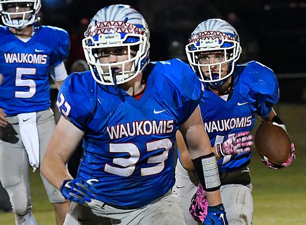 Waukomis' Lane Briggs follows the blocking of Kade Wheeler against Cherokee Friday October 14, 2016 at Waukomis High School. (Billy Hefton / Enid News & Eagle)