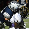 Enid's Kros Bat tackles Midwest City's Arlenza Whittenberg Friday October 28, 2016 at D. Bruce Selby Stadium. (Billy Hefton / Enid News & Eagle)
