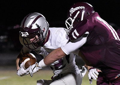 Garber's Matthew Butzbach tries to pull away from Pioneer's Kody McVey Friday October 20, 2016 at Pioneer High School. (Billy Hefton / Enid News & Eagle)