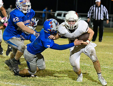 Cherokee's Jarrett James tries to break the tackle of Waukomis' Phillip Busbee Friday October 14, 2016 at Waukomis High School. (Billy Hefton / Enid News & Eagle)
