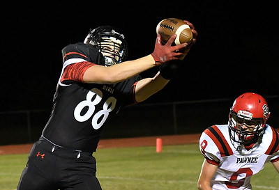 OBA's Doug Regier catches a pass in front of Pawnee's Logan venable Friday October 21, 2016. (Billy Hefton / Enid News & Eagle)