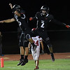 OBA's Hunter Grimm and Will LeForce celebrate a touchdown against Pawnee Friday October 21, 2016. (Billy Hefton / Enid News & Eagle)