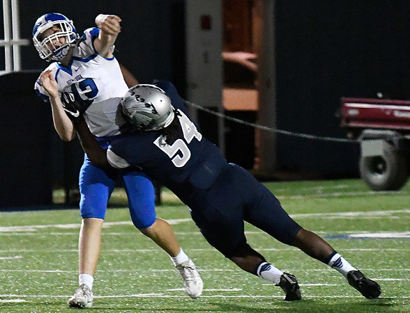 Enid's Corey Slaughter hits Deer Creek's Axel Welch Friday October 7, 2016 at D. Bruce Selby Stadium in Enid. (Billy Hefton / Enid News & Eagle)