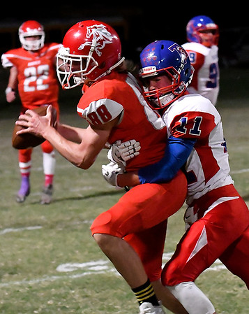 Kremlin-Hillsdale's Seth Schrader holds onto a pass while being hit by Sharon-Mutual's Jerrett Darden Thursday October 13, 2016 in Kremlin. (Billy Hefton / Enid News & Eagle)