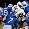 Waukomis defense combines to stop Cherokee's Cody Gilstrap Friday October 14, 2016 at Waukomis High School. (Billy Hefton / Enid News & Eagle)