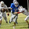 Waukomis quarterback, Hunter Lovell, tries to get away from Cherokee's Jarrett James and Garrett Padilla Friday October 14, 2016 at Waukomis High School. (Billy Hefton / Enid News & Eagle)