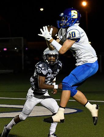 Stillwater's Garrett Leming catches a pass infront of Enid's Jerra Williams Thursday October 19, 2017 at D. Bruce Selby Stadium in Enid. (Billy Hefton / Enid News & Eagle)