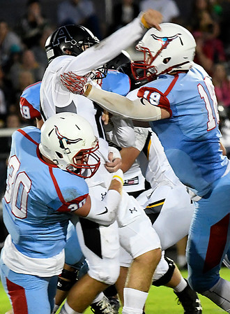 Chisholm's Clay Ashcraft, Noah Hann and Rhett Weber hits Alva quarterback, Mitchell Meyer Friday October 6, 2017. (Billy Hefton / Enid News & Eagle)