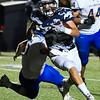 Enid's Mason Skrimager scrambles away from Stillwater defenders Thursday October 19, 2017 at D. Bruce Selby Stadium in Enid. (Billy Hefton / Enid News & Eagle)