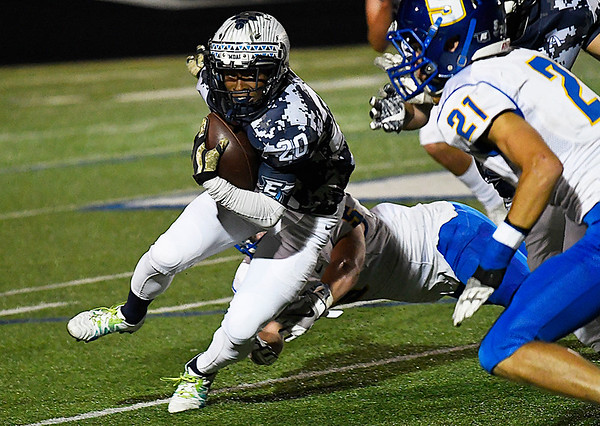 Enid's Khalid Lee runs the ball against Stillwater Thursday October 19, 2017 at D. Bruce Selby Stadium in Enid. (Billy Hefton / Enid News & Eagle)