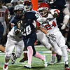 Enid's Khalid Lee tries to outrun Lawton's Calvin Shannon Friday October 13, 2017 at D. Bruce Selby Stadium in Enid. (Billy Hefton / Enid News & Eagle)