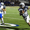 Enid's Jerra Williams runs after making a catch against Stillwater Thursday October 19, 2017 at D. Bruce Selby Stadium in Enid. (Billy Hefton / Enid News & Eagle)