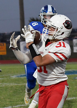 Medford's Brayden Keller catches a pass against Covington-Douglas Thursday October 12, 2017. (Billy Hefton / Enid News & Eagle)