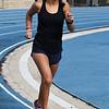 Enid's Genesis Carrillo jogs on the Enid High School track Wednesday October 17, 2018. (Billy Hefton / Enid News & Eagle)