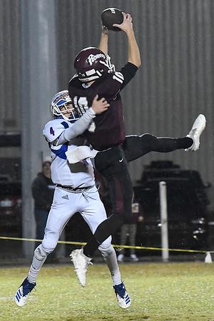 Pioneer's Garrett Mason makes a leaping catch against Waukomis' Kean Eck Thursday October 18, 2018 at Pioneer High School. (Billy Hefton / Enid News & Eagle)