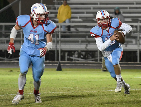 Chisholm's Braden Meek follows Garrett McDowell around end against Centennial Friday October 12, 2018 at Chisholm High School. (Billy Hefton / Enid News & Eagle)