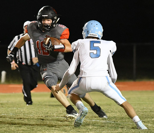 OBA's Connor Colby carries the ball against Okeene's Cole Schmidt Friday October 5, 2018. (Billy Hefton / Enid News & Eagle)