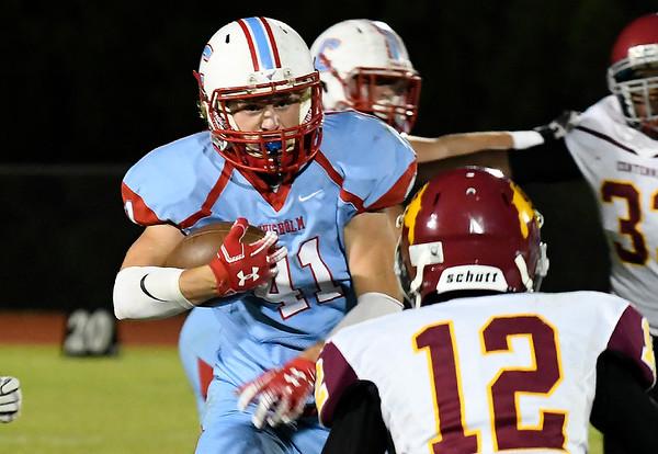 Chisholm's Garrett McDowell carries the ball against Centennial Friday October 12, 2018 at Chisholm High School. (Billy Hefton / Enid News & Eagle)